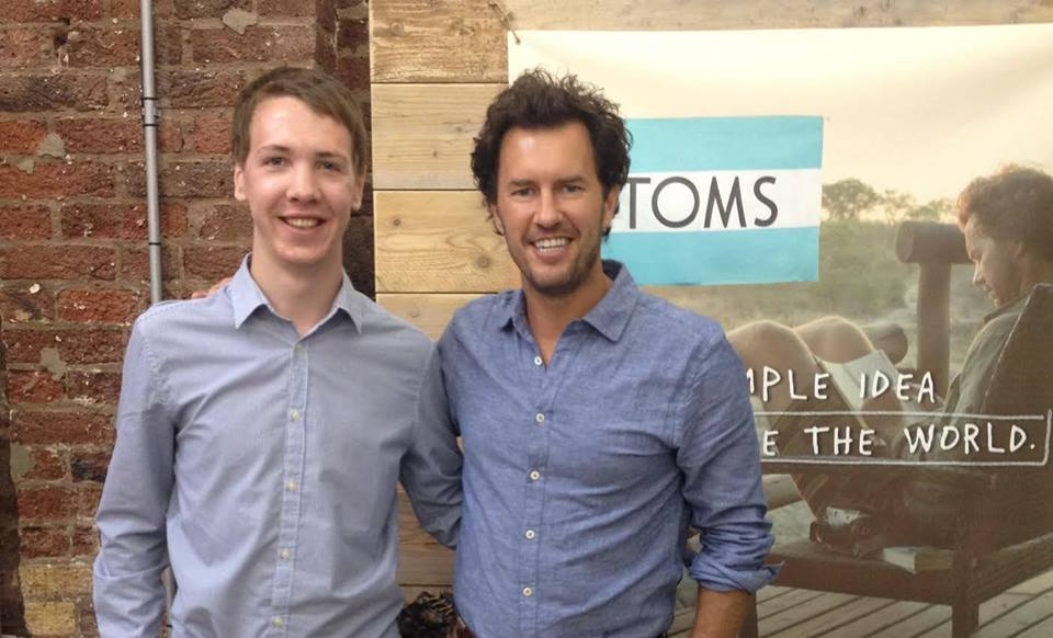 James Holden with Blake Mycoskie of TOMs Shoes